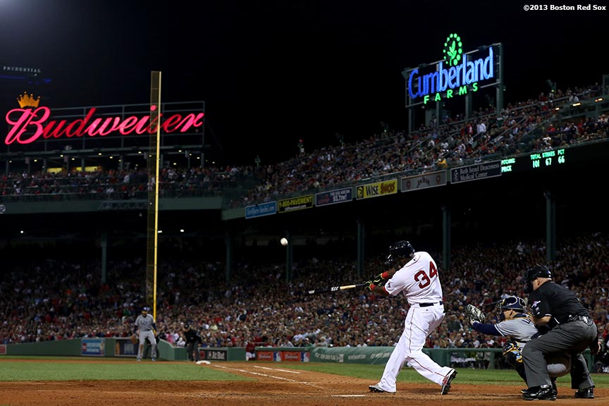 """Boston Red Sox designated hitter David Ortiz hits a home run during the eighth inning of game two of the American League Division Series against the Tampa Bay Rays Saturday, October 5, 2013 at Fenway Park in Boston, Massachusetts."""