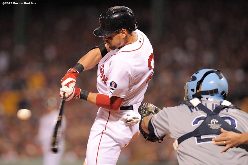 """Boston Red Sox center fielder Jacoby Ellsbury hits an RBI single during the third inning of game two of the American League Division Series against the Tampa Bay Rays Saturday, October 5, 2013 at Fenway Park in Boston, Massachusetts."""