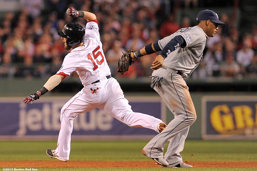 """Boston Red Sox second baseman Dustin Pedroia avoids a tag from shortstop Yunel Escobar during the fourth inning of game two of the American League Division Series against the Tampa Bay Rays Saturday, October 5, 2013 at Fenway Park in Boston, Massachusetts."""
