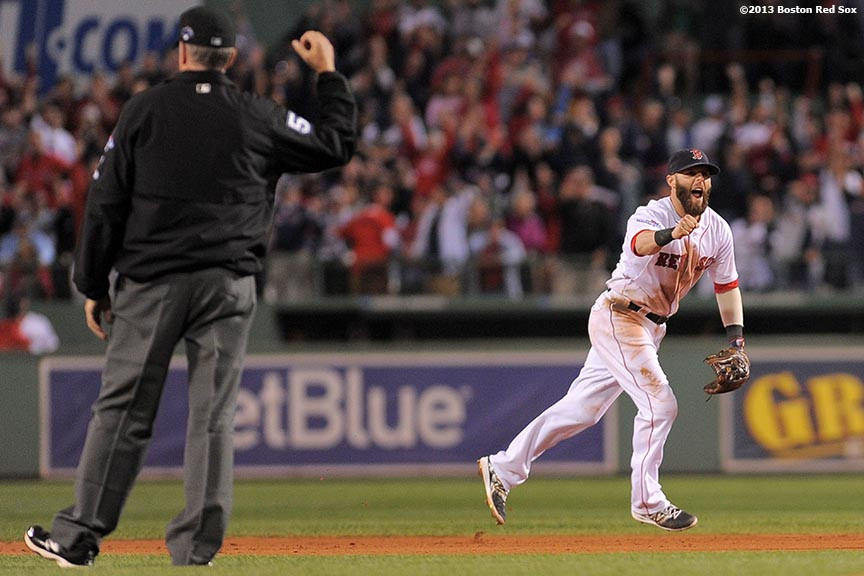 """Boston Red Sox second baseman Dustin Pedroia reacts after completing a double play to end the top of the eighth inning of game two of the American League Division Series against the Tampa Bay Rays Saturday, October 5, 2013 at Fenway Park in Boston, Massachusetts."""