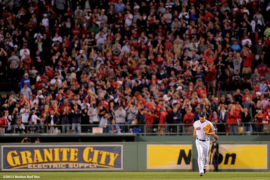 """""""Boston Red Sox closer Koji Uehara runs onto the field before the ninth inning of game two of the American League Division Series against the Tampa Bay Rays Saturday, October 5, 2013 at Fenway Park in Boston, Massachusetts."""""""