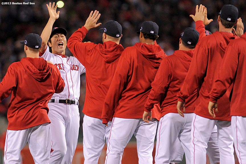 """Boston Red Sox pitcher Koji Uehara celebrates after defeating the Tampa Bay Rays 7-4 in game two of the American League Division Series to take a 2-0 series lead Saturday, October 5, 2013 at Fenway Park in Boston, Massachusetts."""