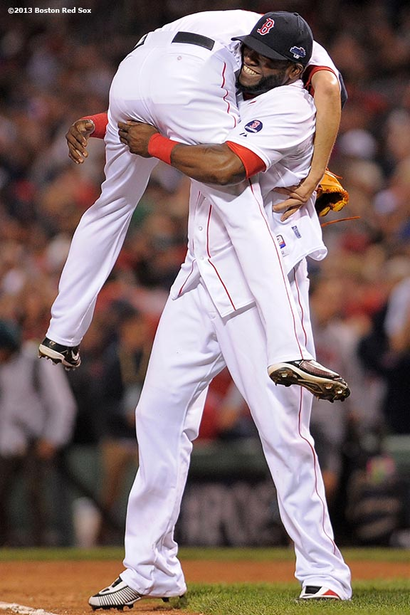 """""""Boston Red Sox designated hitter David Ortiz picks up pitcher Koji Uehara after defeating the Tampa Bay Rays 7-4 in game two of the American League Division Series to take a 2-0 series lead Saturday, October 5, 2013 at Fenway Park in Boston, Massachusetts."""""""
