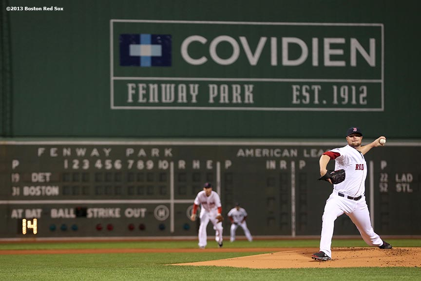 """""""Boston Red Sox pitcher Jon Lester delivers during the first inning of game one of the American League Championship Series against the Detroit Tigers Saturday, October 12, 2013 at Fenway Park in Boston, Massachusetts."""""""