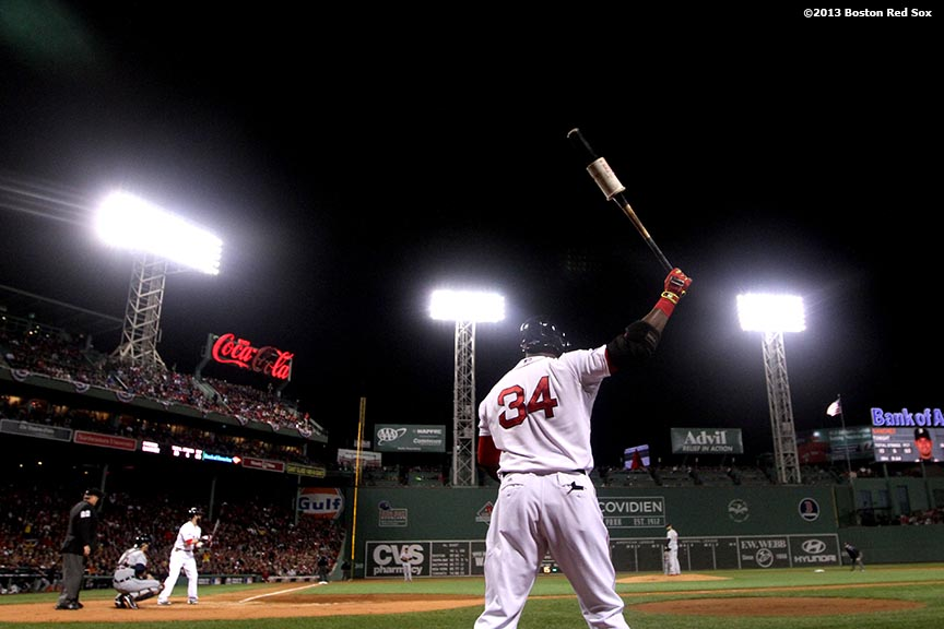 """Boston Red Sox designated hitter David Ortiz warms up on-Deck during the first inning of game one of the American League Championship Series against the Detroit Tigers Saturday, October 12, 2013 at Fenway Park in Boston, Massachusetts."""