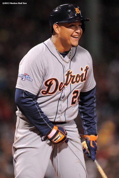 """Detroit Tigers third baseman Miguel Cabrera jokes during the first inning of game one of the American League Championship Series against the Boston Red Sox Saturday, October 12, 2013 at Fenway Park in Boston, Massachusetts."""