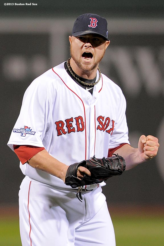 """""""Boston Red Sox pitcher Jon Lester reacts during the fifth inning of game one of the American League Championship Series against the Detroit Tigers Saturday, October 12, 2013 at Fenway Park in Boston, Massachusetts."""""""