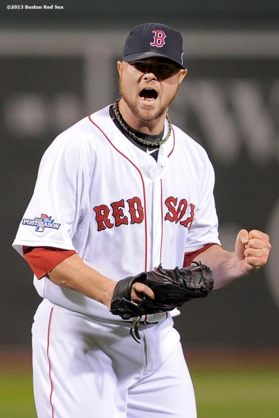 """Boston Red Sox pitcher Jon Lester reacts during the fifth inning of game one of the American League Championship Series against the Detroit Tigers Saturday, October 12, 2013 at Fenway Park in Boston, Massachusetts."""