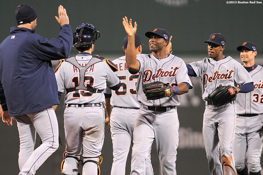"""Detroit Tigers right fielder Torii Hunter high fives teammates after game one of the American League Championship Series agains the Boston Red Sox. aturday, October 12, 2013 at Fenway Park in Boston, Massachusetts."""