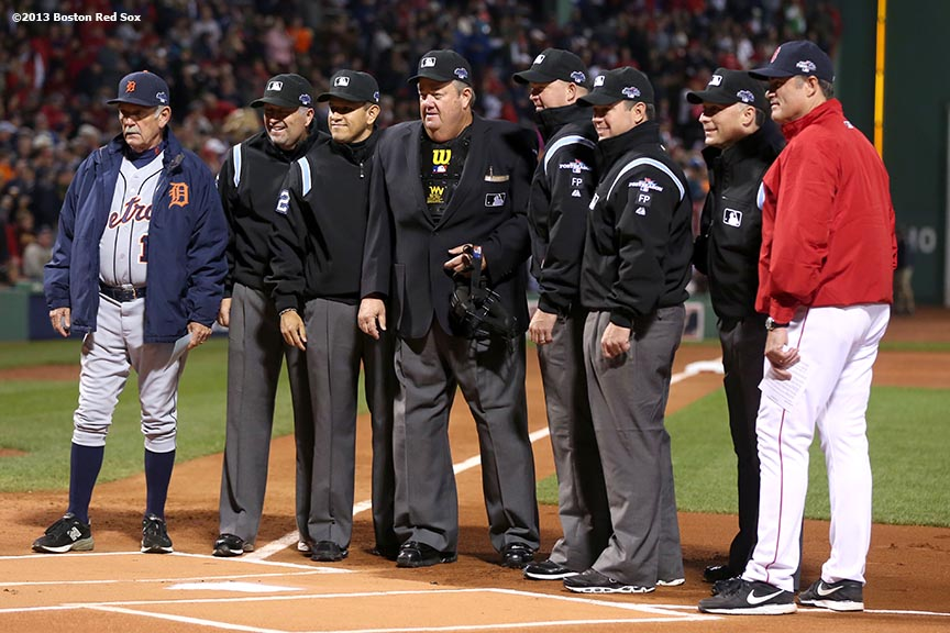 """The umpiring crew, Detroit Tigers manager Jim Leyland and Boston Red Sox manager John Farrell pose for a photograph during a pre-game ceremony before game one of the American League Championship Series between the Boston Red Sox and the Detroit Tigers Saturday, October 12, 2013 at Fenway Park in Boston, Massachusetts."""