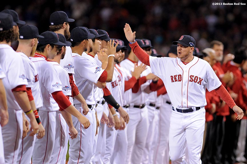 """Boston Red Sox pitcher Jake Peavy high fives teammates during a pre-game ceremony before game one of the American League Championship Series between the Boston Red Sox and the Detroit Tigers Saturday, October 12, 2013 at Fenway Park in Boston, Massachusetts."""