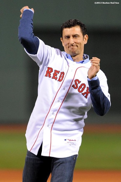 """Former Boston Red Sox shortstop Nomar Garciaparra throws out the ceremonial first pitch before game one of the American League Championship Series between the Boston Red Sox and the Detroit Tigers Saturday, October 12, 2013 at Fenway Park in Boston, Massachusetts."""
