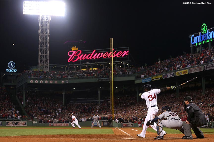 """Boston Red Sox designated hitter David Ortiz hits a game-tying grand slam home run during the eighth inning of game two of the American League Championship Series against the Detroit Tigers Sunday, October 13, 2013 at Fenway Park in Boston, Massachusetts. The Red Sox came back from a 5-0 deficit to defeat the Tigers 6-5."""