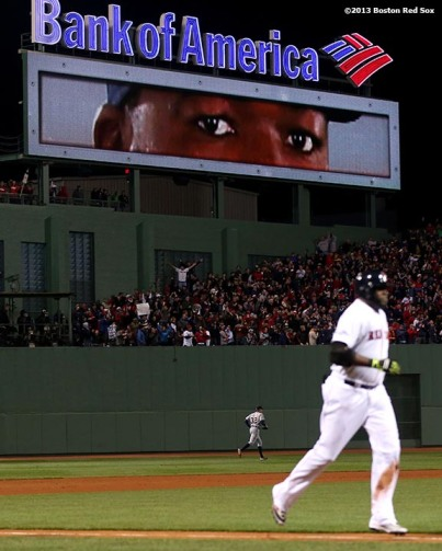 """The eyes of Boston Red Sox designated hitter David Ortiz are displayed on the video board at Fenway Park as he rounds the bases after hitting a game-tying grand slam home run during the eighth inning of game two of the American League Championship Series against the Detroit Tigers Sunday, October 13, 2013 at Fenway Park in Boston, Massachusetts."""