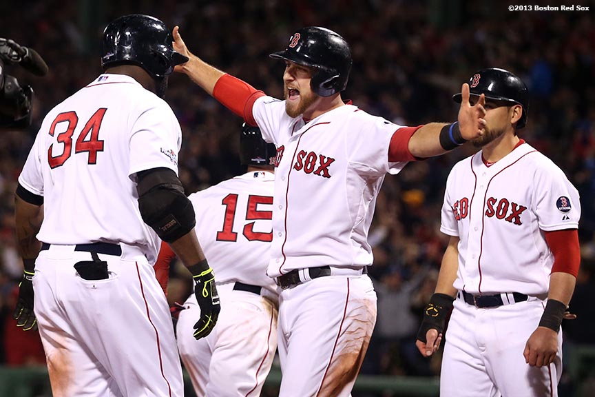 """""""Boston Red Sox third baseman Will Middlebrooks congratulates designated hitter David Ortiz after Ortiz hit a game-tying grand slam home run during the eighth inning of game two of the American League Championship Series against the Detroit Tigers Sunday, October 13, 2013 at Fenway Park in Boston, Massachusetts."""""""