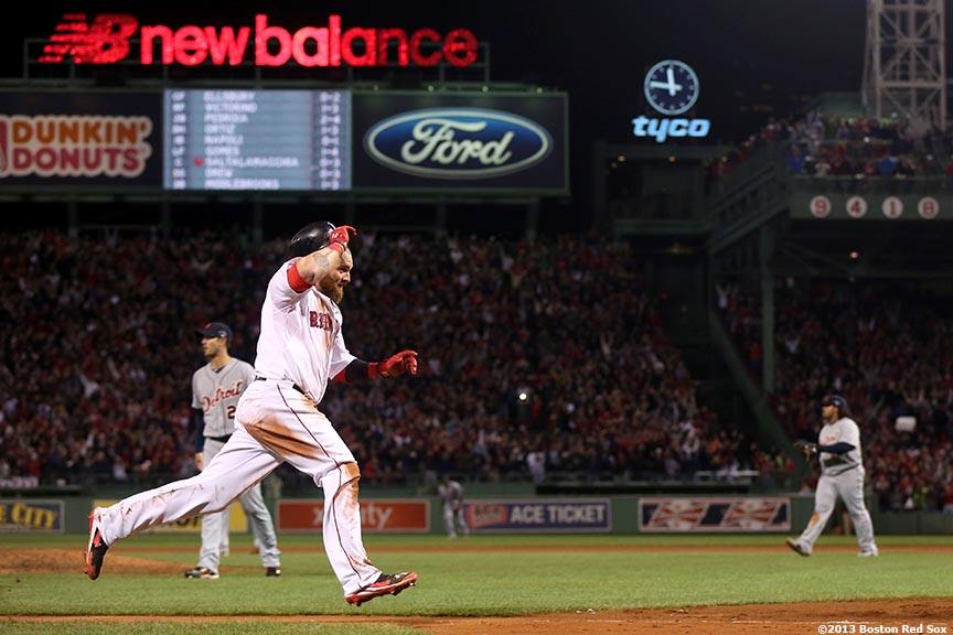 """Boston Red Sox left fielder Jonny Gomes celebrates as he scores the game-winning run on a walk-off single by catcher Jarrod Saltalamacchia during the ninth inning of game two of the American League Championship Series against the Detroit Tigers Sunday, October 13, 2013 at Fenway Park in Boston, Massachusetts."""