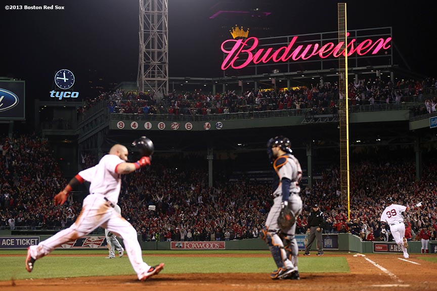 """Boston Red Sox catcher Jarrod Saltalamacchia (right) celebrates after hitting a game-winning walk off RBI single to score left fielder Jonny Gomes during the ninth inning of game two of the American League Championship Series against the Detroit Tigers Sunday, October 13, 2013 at Fenway Park in Boston, Massachusetts. The Red Sox came back from a 5-0 deficit to defeat the Tigers 6-5."""