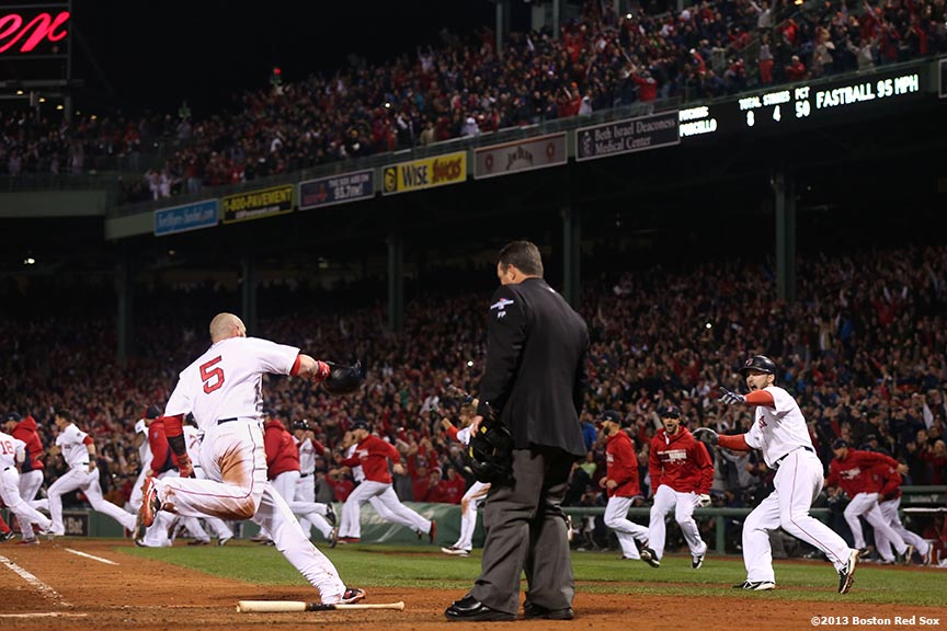 """Boston Red Sox left fielder Jonny Gomes and shortstop Stephen Drew celebrate as Gomes scores the game-winning run on a walk-off single by catcher Jarrod Saltalamacchia during the ninth inning of game two of the American League Championship Series against the Detroit Tigers Sunday, October 13, 2013 at Fenway Park in Boston, Massachusetts."""