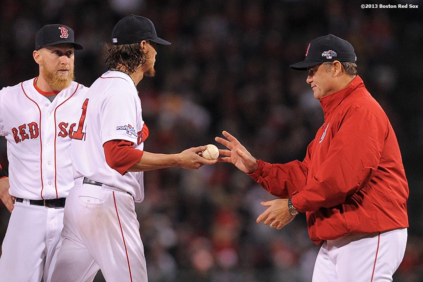 """Boston Red Sox pitcher Clay Buchholz gives the ball to manager John Farrell as Buchholz exits the game during the sixth inning of game two of the American League Championship Series against the Detroit Tigers Sunday, October 13, 2013 at Fenway Park in Boston, Massachusetts."""