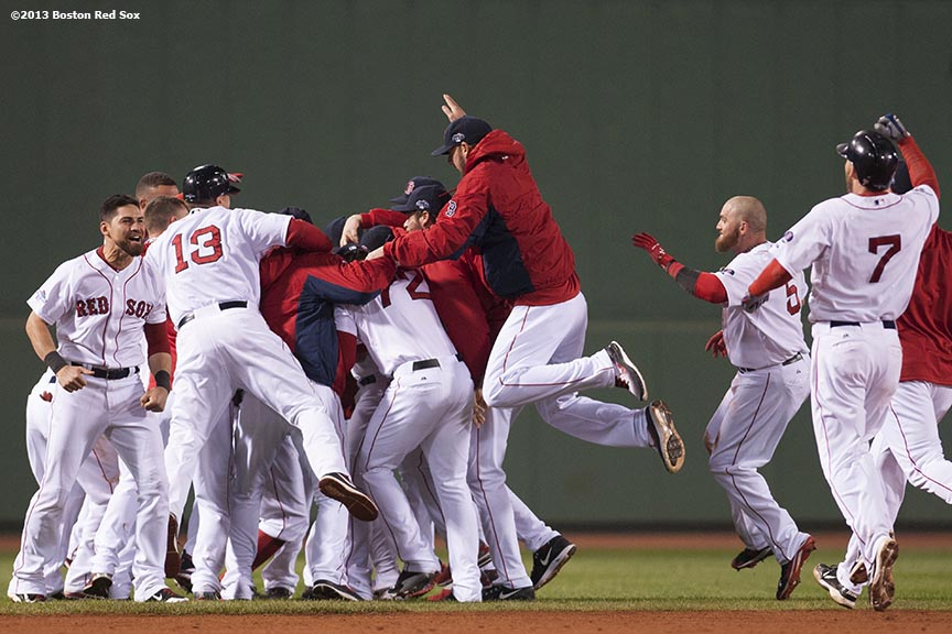 """Boston Red Sox players mob catcher Jarrod Saltalamacchia after Saltalamacchia hit a game-winning RBI single during the ninth inning of game two of the American League Championship Series against the Detroit Tigers Sunday, October 13, 2013 at Fenway Park in Boston, Massachusetts. The Red Sox came back from a 5-0 deficit to defeat the Tigers 6-5."""