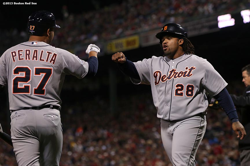 """Detroit Tigers shortstop Jhonny Peralta celebrates with first baseman Prince Fielder after Fielder scored during the sixth inning of game two of the American League Championship Series against the Boston Red Sox Sunday, October 13, 2013 at Fenway Park in Boston, Massachusetts."""