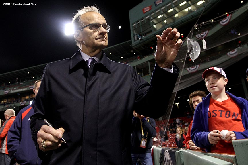 """Major League Baseball Executive Vice President of Baseball Operations Joe Torre signs autographs before game two of the American League Championship Series between the Boston Red Sox and the Detroit Tigers Sunday, October 13, 2013 at Fenway Park in Boston, Massachusetts."""