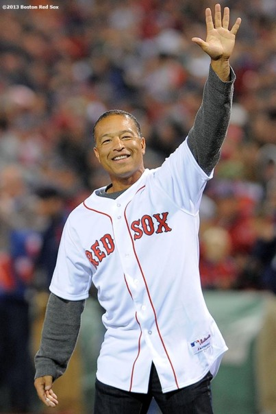 """Former Boston Red Sox player Dave Roberts waves to the crowd before throwing out the ceremonial first pitch during a pre-game ceremony before game two of the American League Championship Series between the Boston Red Sox and the Detroit Tigers Sunday, October 13, 2013 at Fenway Park in Boston, Massachusetts."""
