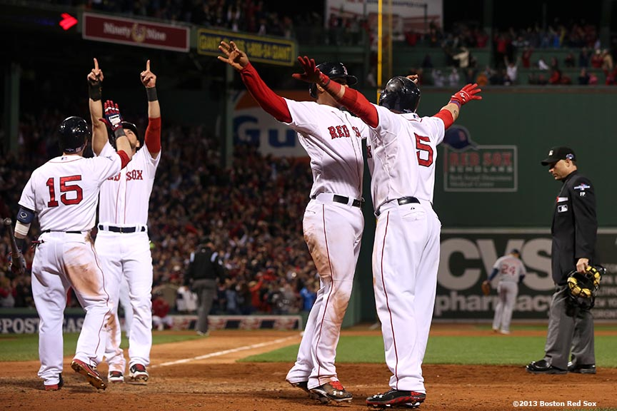 """Boston Red Sox center fielder Jacoby Ellsbury, second baseman Dustin Pedroia and left fielder Jonny Gomes celebrate after right fielder Shane Victorino hit a go-ahead grand slam home run during the seventh inning of game six of the American League Championship Series against the Detroit Tigers Saturday, October 19, 2013 at Fenway Park in Boston, Massachusetts."""