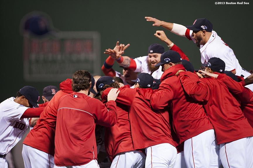 """Boston Red Sox players celebrate after winning game six of the American League Championship Series against the Detroit Tigers and advancing to the World Series Saturday, October 19, 2013 at Fenway Park in Boston, Massachusetts."""