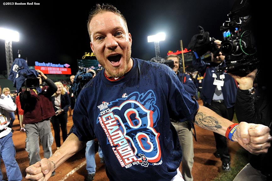 """Boston Red Sox pitcher Jake Peavy reacts after receiving an ice bath during an on-field celebration after winning game six of the American League Championship Series against the Detroit Tigers and advancing to the World Series Saturday, October 19, 2013 at Fenway Park in Boston, Massachusetts."""