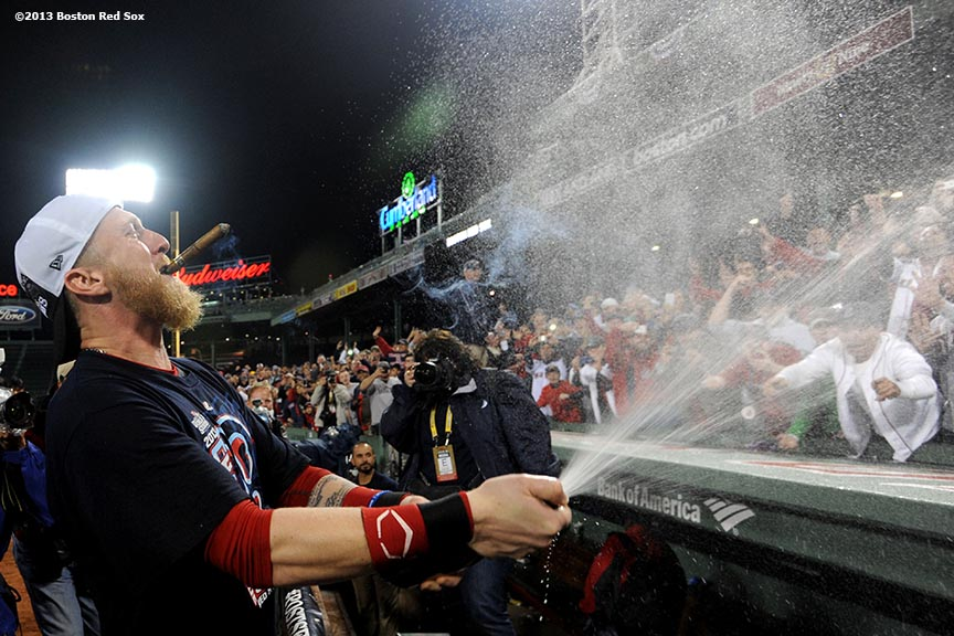 """Boston Red Sox outfielder Mike Carp sprays Champagne during an on-field celebration after winning game six of the American League Championship Series against the Detroit Tigers and advancing to the World Series Saturday, October 19, 2013 at Fenway Park in Boston, Massachusetts."""