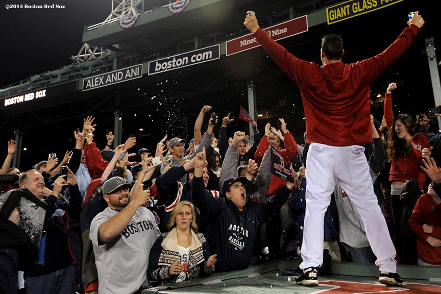 """Boston Red Sox catcher Ryan Lavarnway gestures to fans during an on-field celebration after winning game six of the American League Championship Series against the Detroit Tigers and advancing to the World Series Saturday, October 19, 2013 at Fenway Park in Boston, Massachusetts."""