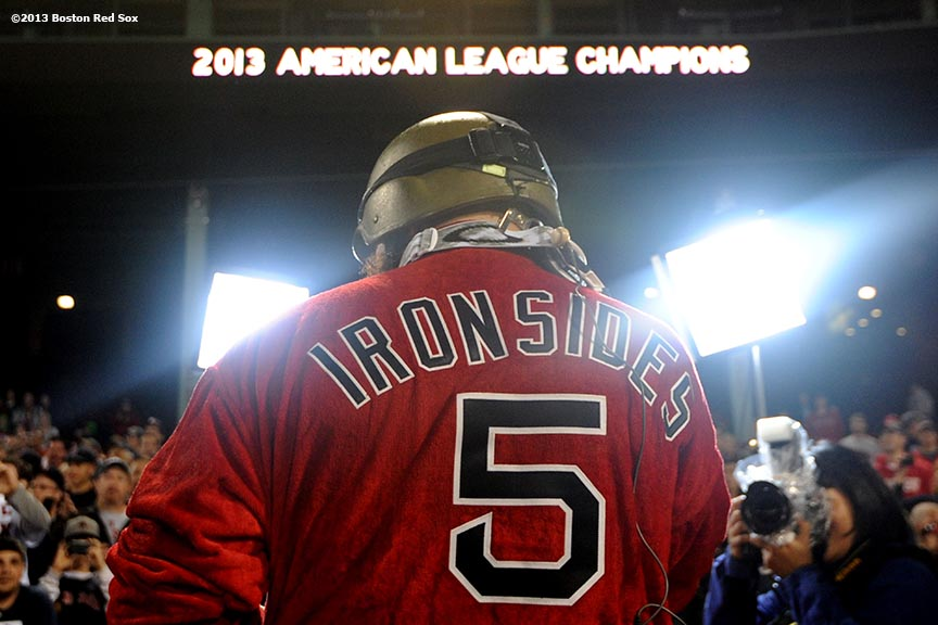 """Boston Red Sox right fielder Jonny Gomes wears an 'Ironsides' Red Sox bathrobe as he celebrates during an on-field celebration after winning game six of the American League Championship Series against the Detroit Tigers and advancing to the World Series Saturday, October 19, 2013 at Fenway Park in Boston, Massachusetts."""