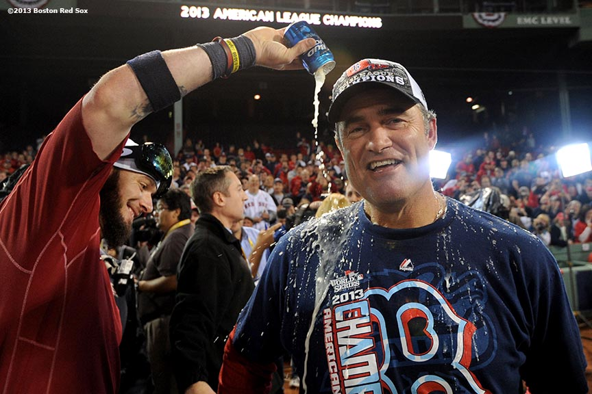 """Boston Red Sox catcher Jarrod Saltalamacchia pours beer on manager John Farrell during an on-field celebration after winning game six of the American League Championship Series against the Detroit Tigers and advancing to the World Series Saturday, October 19, 2013 at Fenway Park in Boston, Massachusetts."""