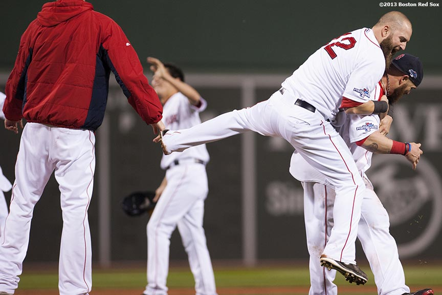 """""""Boston Red Sox first baseman Mike Napoli jumps on right fielder Jonny Gomes after winning game six of the American League Championship Series against the Detroit Tigers and advancing to the World Series Saturday, October 19, 2013 at Fenway Park in Boston, Massachusetts."""""""
