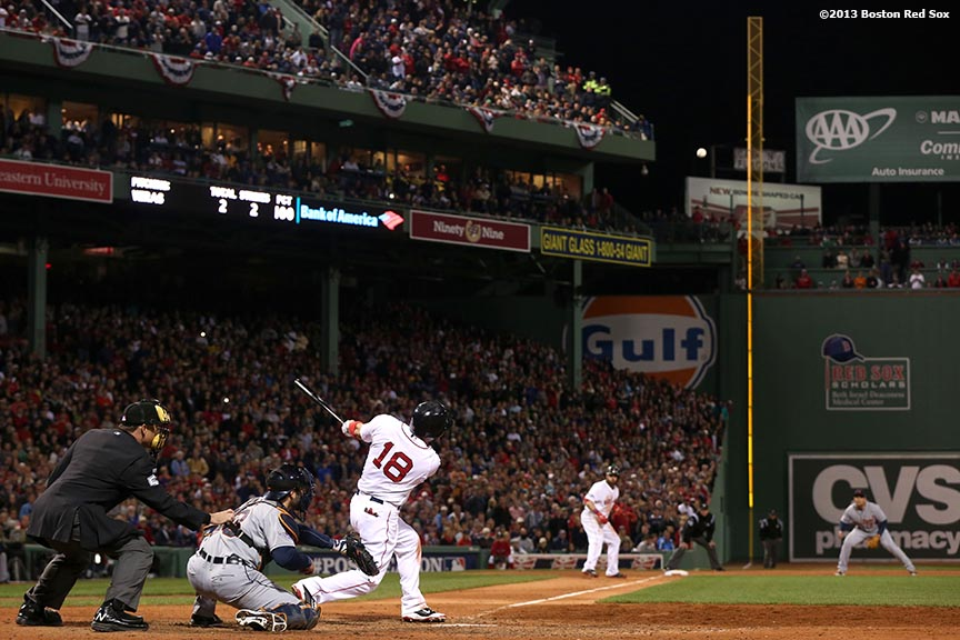 """Boston Red Sox right fielder Shane Victorino hits a go-ahead grand slam home run during the seventh inning of game six of the American League Championship Series against the Detroit Tigers Saturday, October 19, 2013 at Fenway Park in Boston, Massachusetts."""