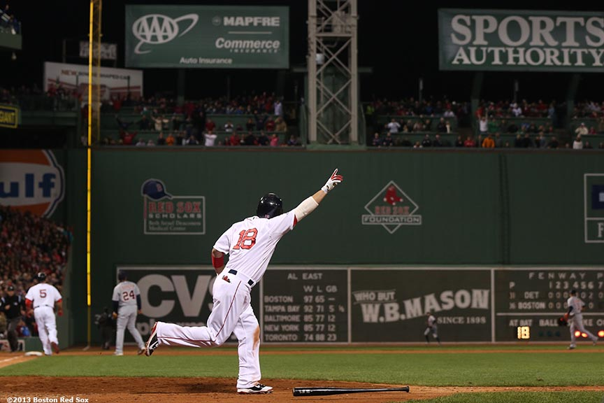 """Boston Red Sox right fielder Shane Victorino celebrates after hitting a go-ahead grand slam home run during the seventh inning of game six of the American League Championship Series against the Detroit Tigers Saturday, October 19, 2013 at Fenway Park in Boston, Massachusetts."""
