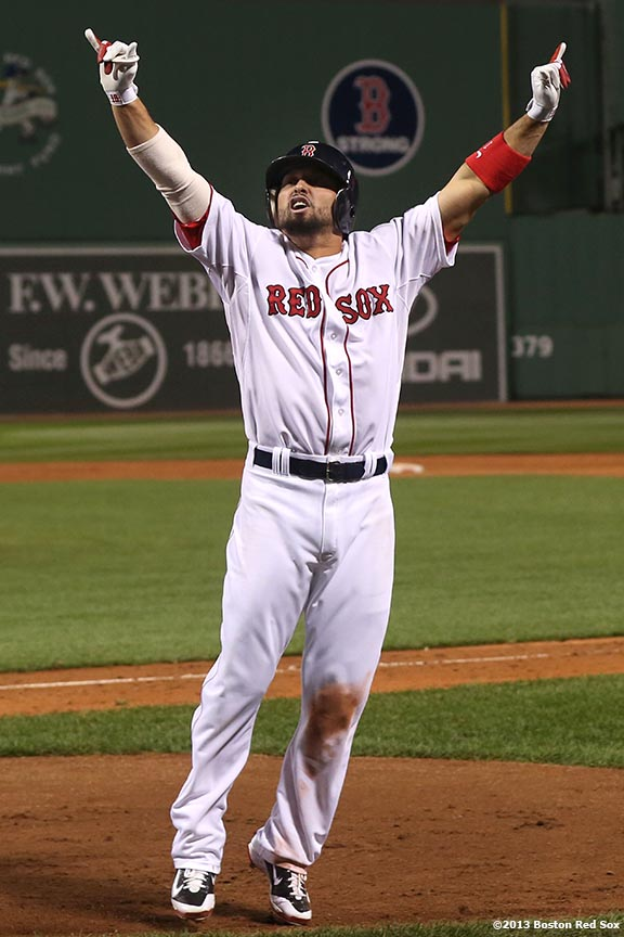 """""""Boston Red Sox right fielder Shane Victorino celebrates after hitting a go-ahead grand slam home run during the seventh inning of game six of the American League Championship Series against the Detroit Tigers Saturday, October 19, 2013 at Fenway Park in Boston, Massachusetts."""""""