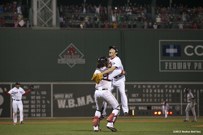 """Boston Red Sox pitcher Koji Uehara and catcher Jarrod Saltalamacchia celebrate after winning game six of the American League Championship Series against the Detroit Tigers and advancing to the World Series Saturday, October 19, 2013 at Fenway Park in Boston, Massachusetts."""