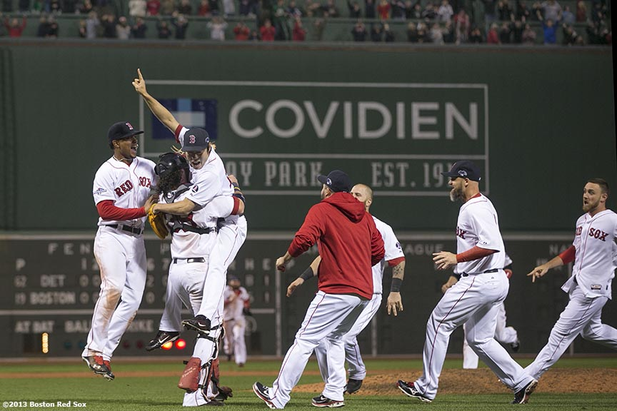 """Boston Red Sox pitcher Koji Uehara, catcher Jarrod Saltalamacchia, and teammates celebrate after winning game six of the American League Championship Series against the Detroit Tigers and advancing to the World Series Saturday, October 19, 2013 at Fenway Park in Boston, Massachusetts."""