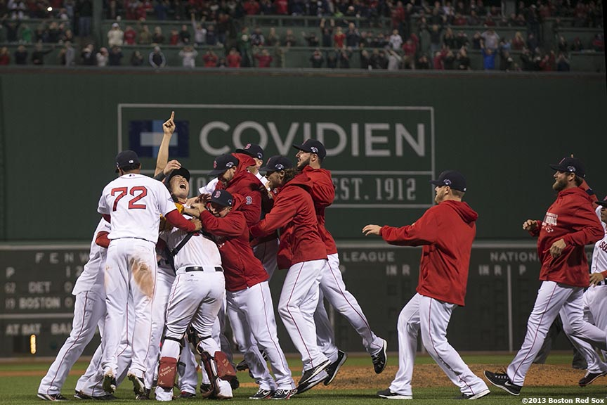 """Boston Red Sox pitcher Koji Uehara celebrates with teammates after winning game six of the American League Championship Series against the Detroit Tigers and advancing to the World Series Saturday, October 19, 2013 at Fenway Park in Boston, Massachusetts."""