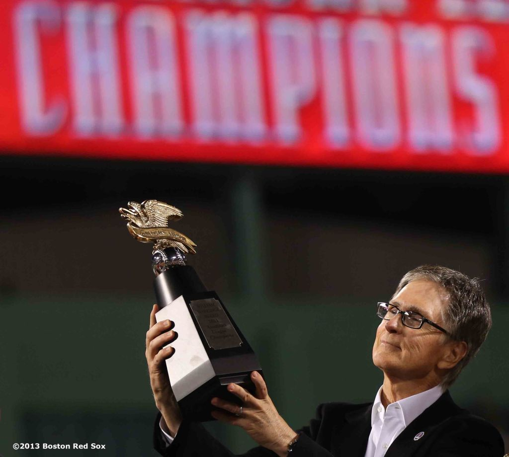 """Boston Red Sox Principal Owner John Henry is presented with the League Championship trophy during an on-field celebration after winning game six of the American League Championship Series against the Detroit Tigers and advancing to the World Series Saturday, October 19, 2013 at Fenway Park in Boston, Massachusetts."""