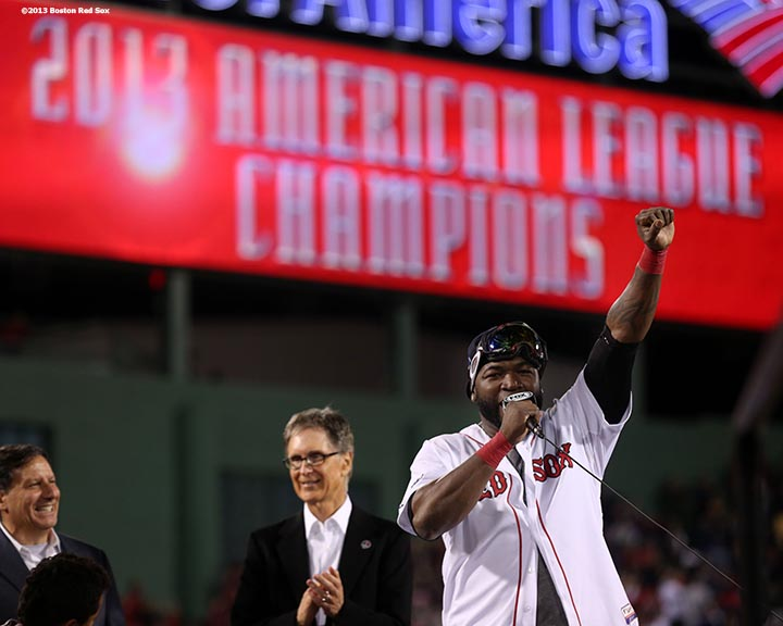 """Boston Red Sox designated hitter David Ortiz gestures to fans during an on-field celebration after winning game six of the American League Championship Series against the Detroit Tigers and advancing to the World Series Saturday, October 19, 2013 at Fenway Park in Boston, Massachusetts."""