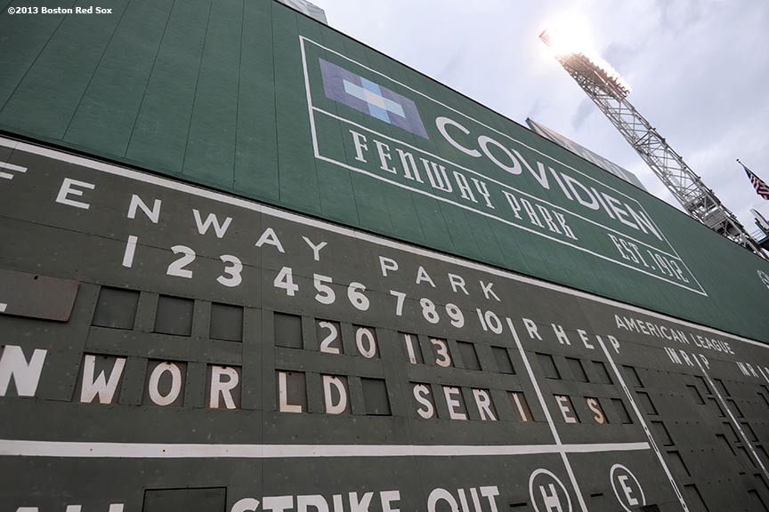"""The Green Monster scoreboard at Fenway Park displays '2013 World Series' before game one of the World Series between the Boston Red Sox and the St. Louis Cardinals  Tuesday, October 22, 2013 at Fenway Park in Boston, Massachusetts."""