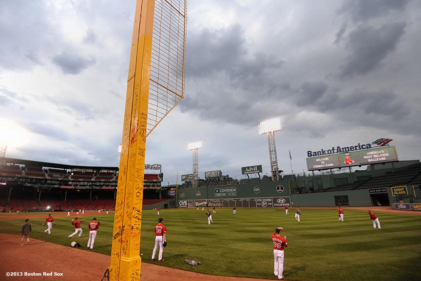 """Boston Red Sox players warm up during a team workout before game one of the 2013 World Series against the St. Louis Cardinals Tuesday, October 22, 2013 at Fenway Park in Boston, Massachusetts."""