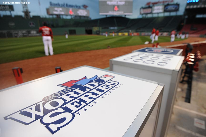 """""""Boston Red Sox players stretch during a team workout before game one of the 2013 World Series against the St. Louis Cardinals Tuesday, October 22, 2013 at Fenway Park in Boston, Massachusetts."""""""