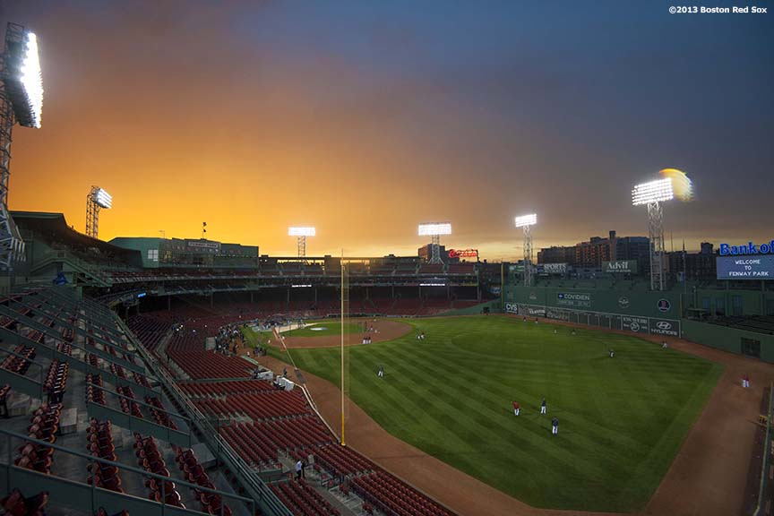 """The sun sets over Fenway Park during a team workout before game one of the 2013 World Series between the Boston Red Sox and the St. Louis Cardinals Tuesday, October 22, 2013 at Fenway Park in Boston, Massachusetts."""