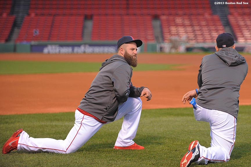 """Boston Red Sox first baseman Mike Napoli stretches during a team workout before game one of the 2013 World Series against the St. Louis Cardinals Tuesday, October 22, 2013 at Fenway Park in Boston, Massachusetts."""
