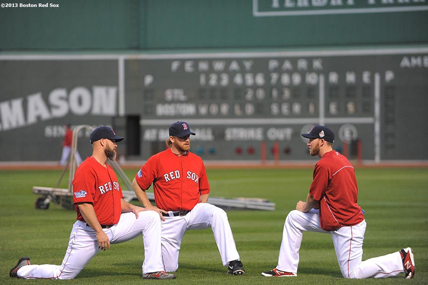 """Boston Red Sox catcher David Ross, pitcher Ryan Dempster, and shortstop Stephen Drew stretch during a team workout before game one of the 2013 World Series against the St. Louis Cardinals Tuesday, October 22, 2013 at Fenway Park in Boston, Massachusetts."""