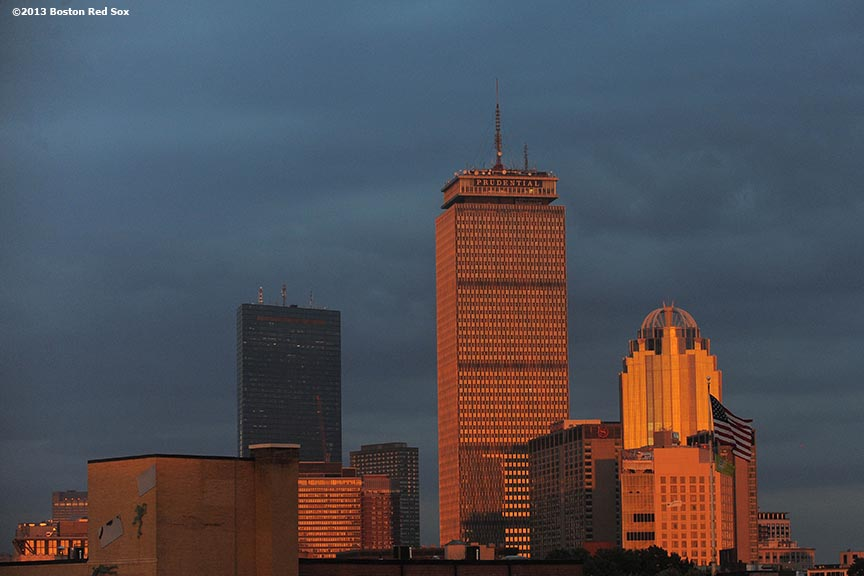 """""""The sun sets over the Boston Skyline during a team workout before game one of the 2013 World Series between the Boston Red Sox and the St. Louis Cardinals Tuesday, October 22, 2013 at Fenway Park in Boston, Massachusetts."""""""